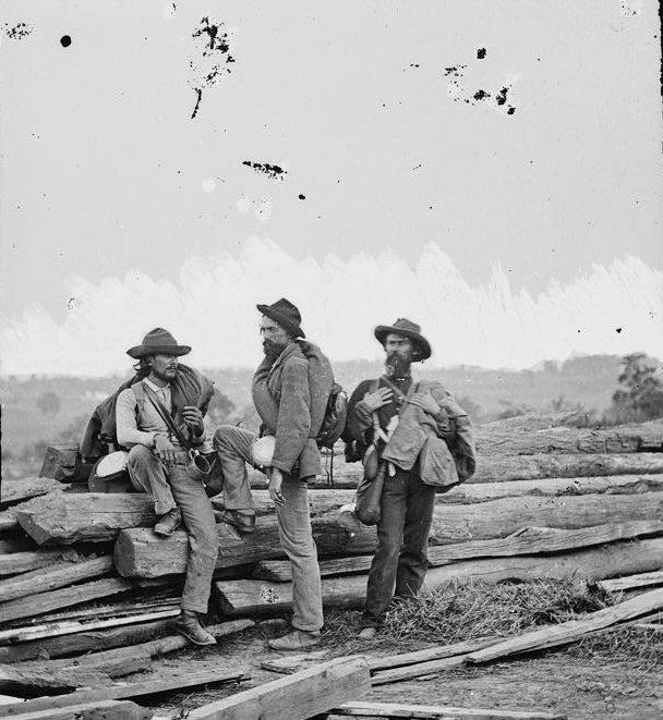 In this iconic photograph of Confederate Prisoners captured near Gettysburg, note the tin cup the man on the left carries.