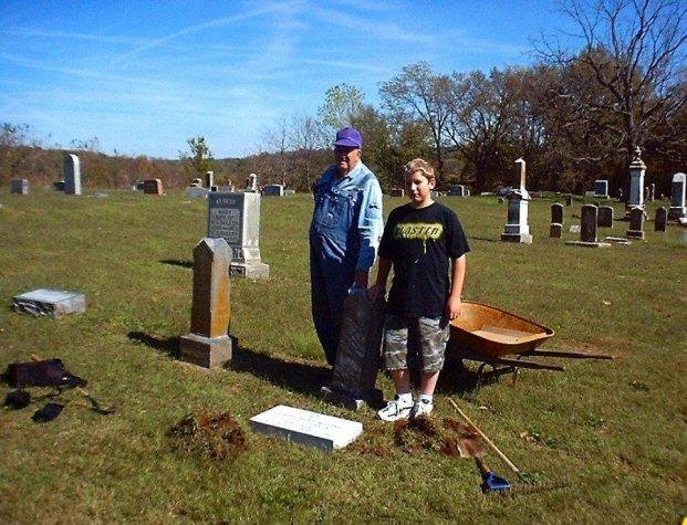 Leon Moore at left, and my stepson, Corbin Hulsizer at right. Along with myself, we were the Stone setting crew on Pvt. Joseph Holt Moores' Stone.