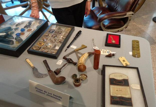Some of Ann's jewelry, a Housewife, Traveling Inkwell, Button Polisher, and other artifacts.