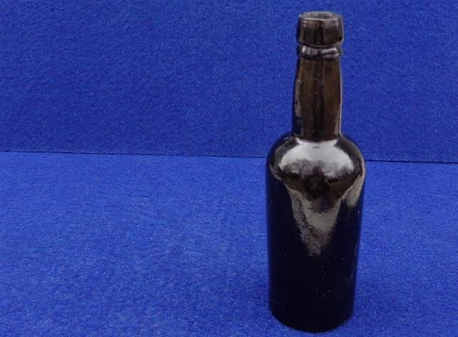 "Fine Civil War Period ""Baby"" or Salesman's Black Glass Whiskey Bottle"