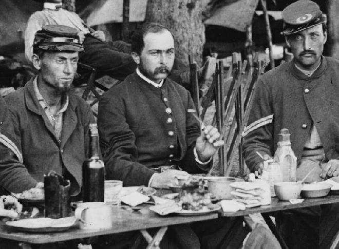 Here are some of the NCOs of Co. D, 93rd New York Infantry. This picture is chock full of interesting stuff. If you have a chance, download the full image at the LOC and give it a look. But for now, notice the size and types of cups on their table.