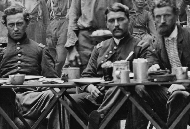 Here are Officers of Co. F, 93rd New York Infantry having dinner at Bealton, Virginia. Again notice the size and shapes of their cups.