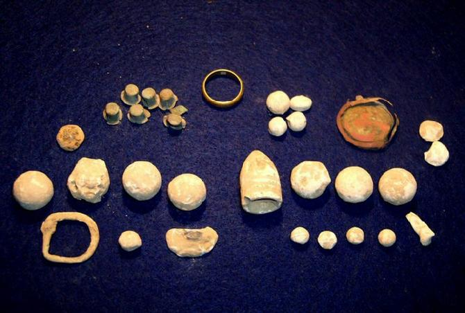 Relics recovered Sunday, 5-13-12, include several musket balls & buck balls, nice conical .69 bullet, badge piece, spur buckle, percussion caps, & gold wedding band.